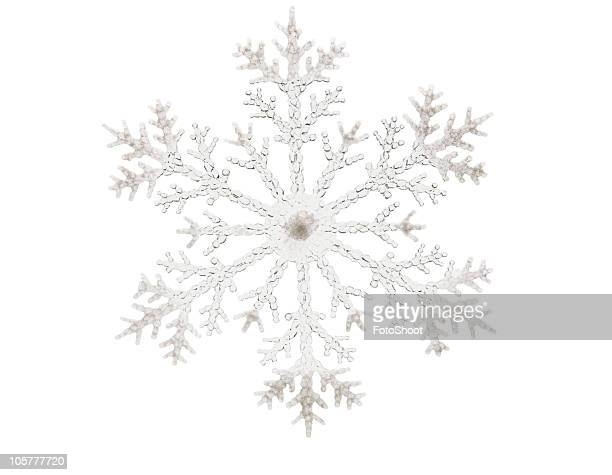 Single glitter snowflake isolated on a white background