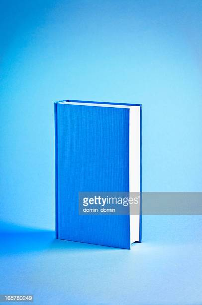Single hardcover book isolated on blue background