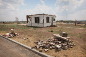 A single home remains standing in what was once a neighborhood prior to the May 22 tornado that destroyed a large section of the city July 29 2011 in...