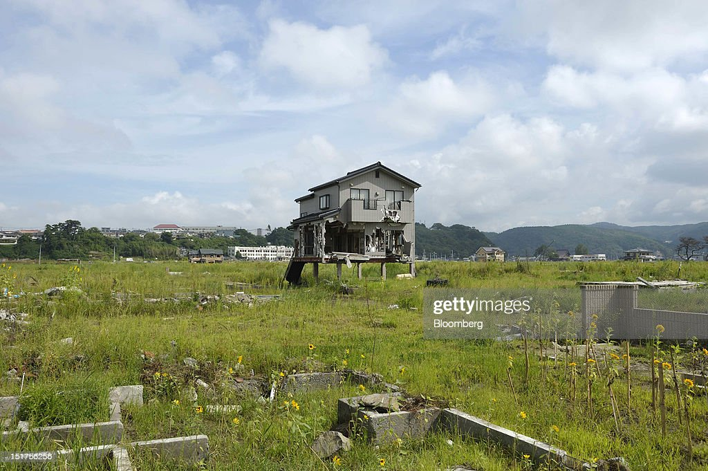 A single house stands in an area damaged by last year's March 11 earthquake and tsunami in Ishinomaki City, Miyagi Prefecture, Japan, on Wednesday, Sept. 5, 2012. Japan's economy expanded in the second quarter at half the pace the government initially estimated, underscoring the risk of a contraction as Europe's debt crisis caps exports. Photographer: Akio Kon/Bloomberg via Getty Images