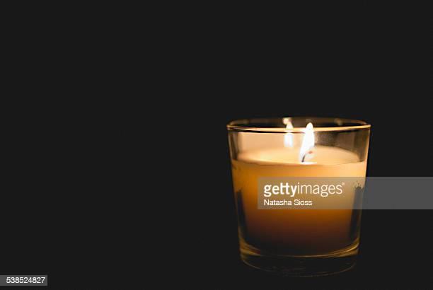 Single illuminated candle