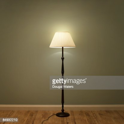Single lamp in green room.