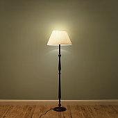 Single lamp in green room.