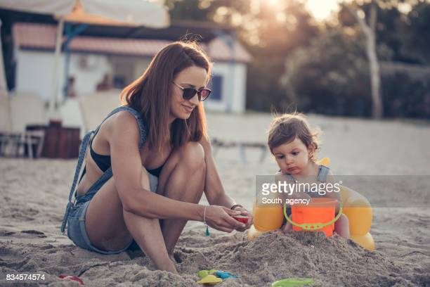 Single mother and daughter at the beach