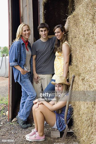 Single Mother and Her Teen Children on the Farm