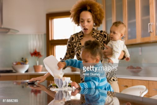 Single Mother Getting Kids Ready in the Morning. : Stock Photo