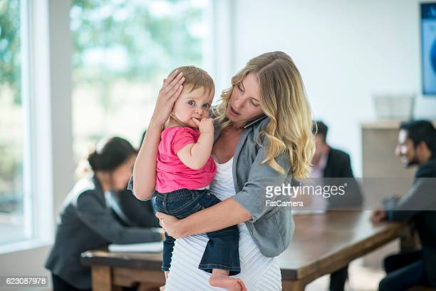 Single Mother with Her Daughter at Work