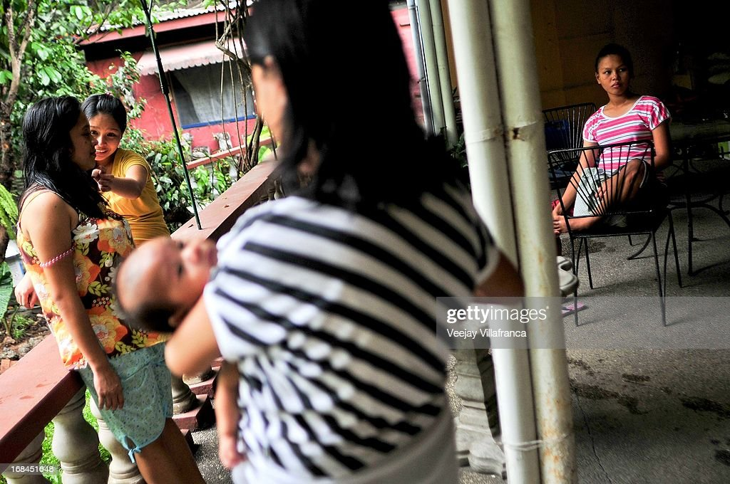 Single mothers coming from different provinces in the Philippines enjoy a relaxing afternoon in at Nazareth House, before Mother's Day this Sunday, on May 10, 2013 in Manila, Philippines. The Nazareth home take in women who are expecting mothers and have no capacity to raise a child due to varied socio-economic reasons. Women in the center usually have suffered mental or sexual abuse and undergo a series of counseling and are also provided maternal health support by the volunteers.
