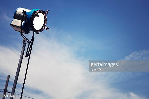 A single movie light with a sky background