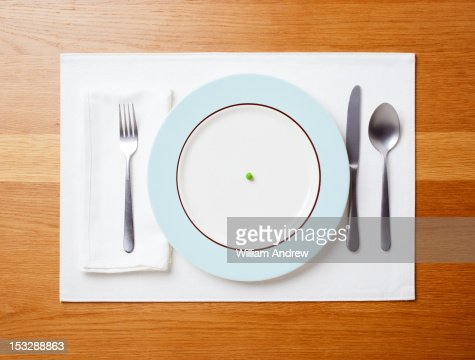 Single pea on a plate : Stock Photo