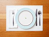 Single pea on a plate