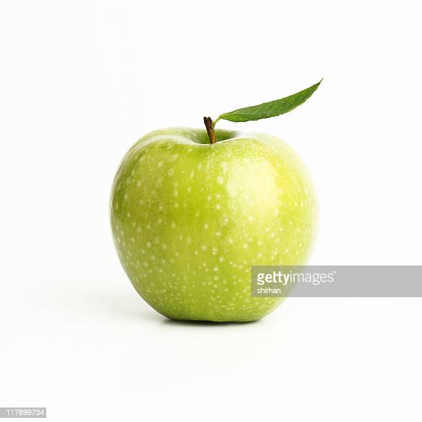 Single perfect green apple on a white background