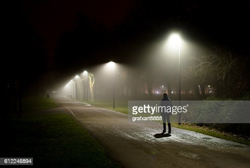 Single Person Walking on Street in the Dark Night : Stock Photo