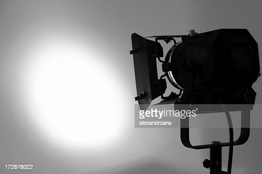 Single piece of lighting equipment lighting a white wall