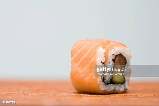 Single piece of salmon maki sushi, close-up