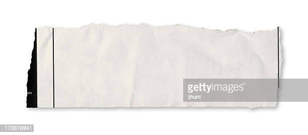 A single piece of torn newspaper on a white background