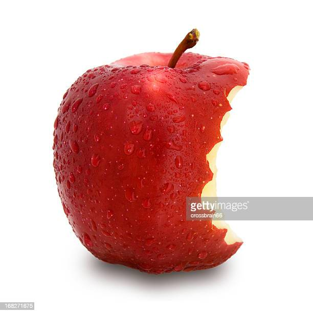 A single red apple with a bite taken out
