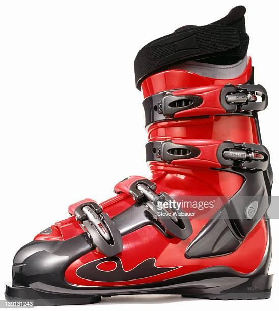A single red modern ski boot