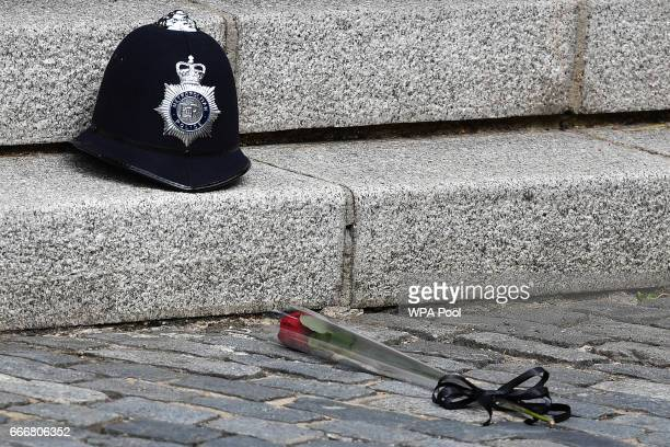 A single red rose is placed beside the police helmet of PC Keith Palmer the officer killed in the March 22 Westminster terror attack at the spot at...