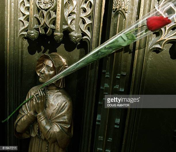 A single red rose sits in the door of St Patrick's Cathedral in New York 03 May 2000 after an announcement that John Cardinal O'Connor the oldest...