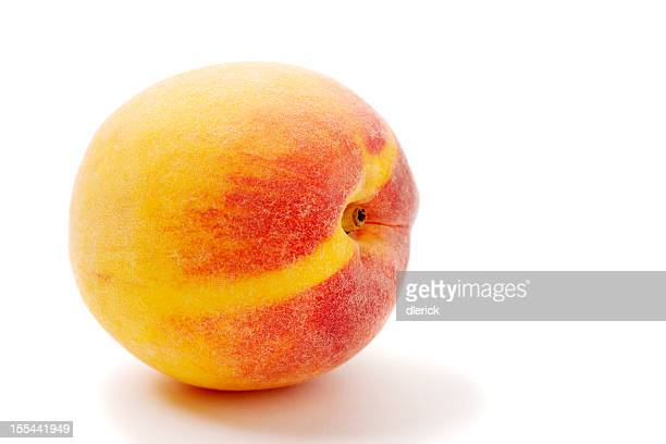 single ripe peach against a plain white background