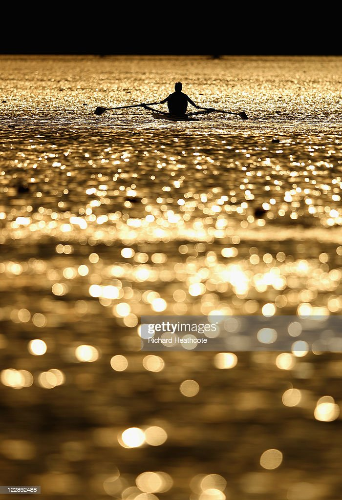 A single sculler on a training run late in the day during day two of the FISA Rowing World Championships at Lake Bled on August 29, 2011 in Bled, Slovenia.