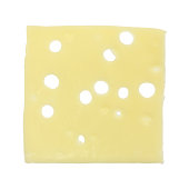 A single slice of low sodium Swiss cheese isolated on a white background.