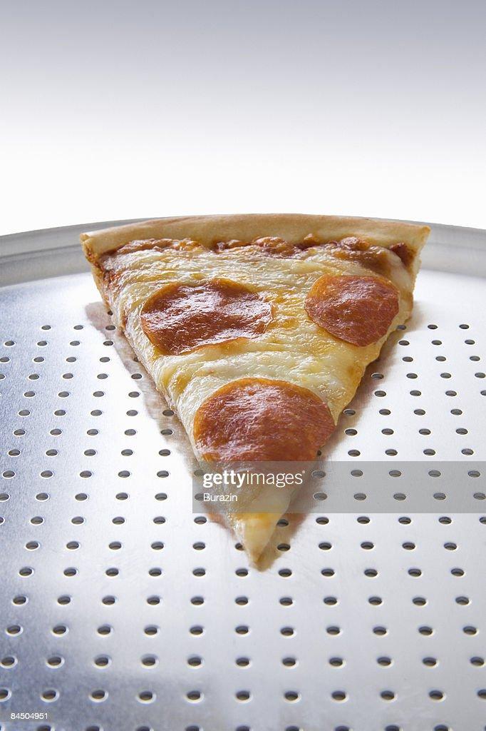 Single slice of pepperoni pizza : Stock Photo