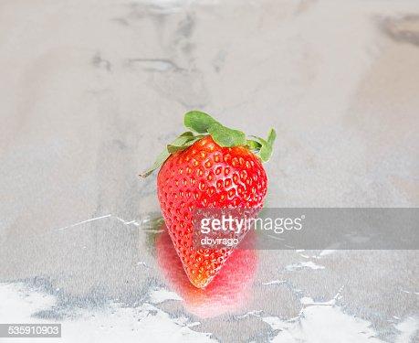 Single Strawberry on Foil : Stock Photo