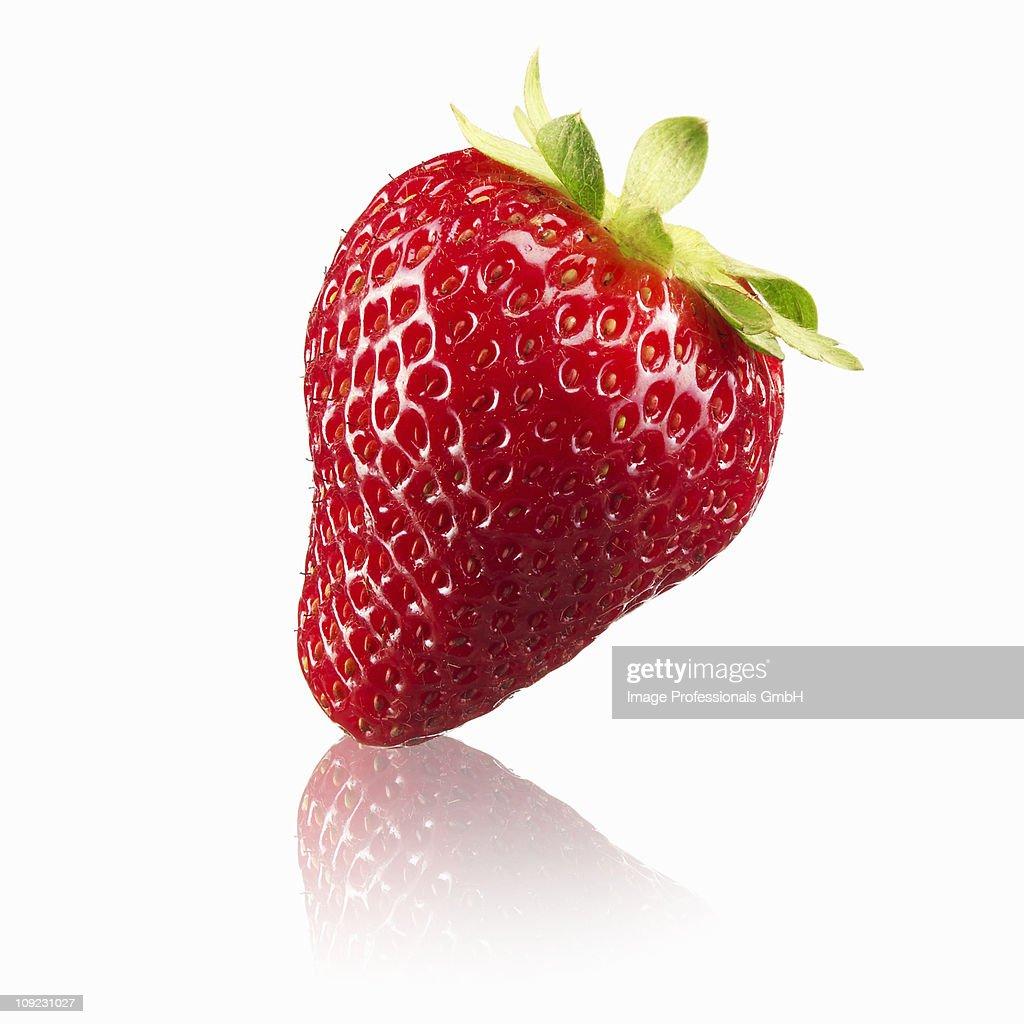 Single strawberry on white background, close-up
