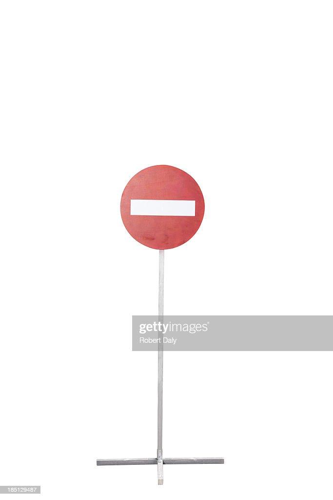 A single street sign on a desolate road