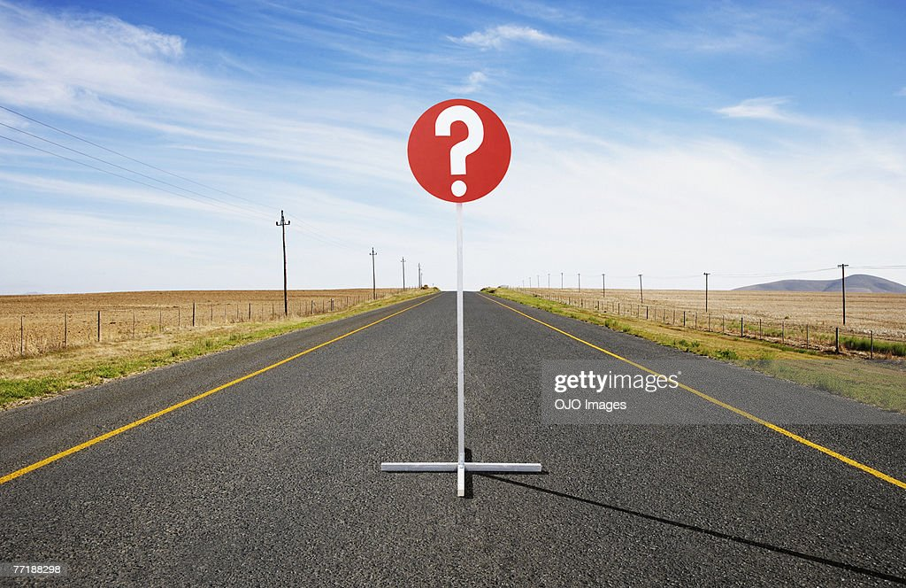 A single street sign on a desolate road : Stock Photo