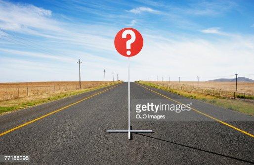 A single street sign on a desolate road : Stock Photo