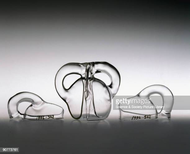 A single surface model made in glass by Alan Bennett in Bedford United Kingdom It consists of a Klein bottle with three loops one of which has been...