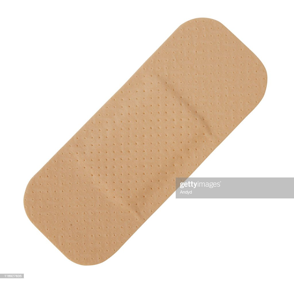 Single tan-colored Band-Aid on a white background