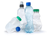 shot of a group of plastic bottles crumpled and discarded ready for the trash and landfill. the image highlights the environmental issues with waste disposal. cut out on a white background with copy s