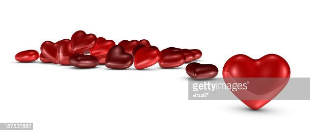 single Valentine's day heart, with bunch at background : Stock Photo