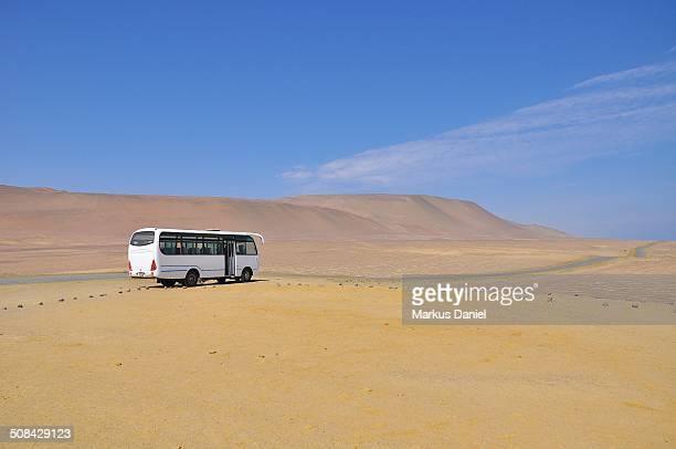 Single White Tour Bus in Desert of Paracas, Peru