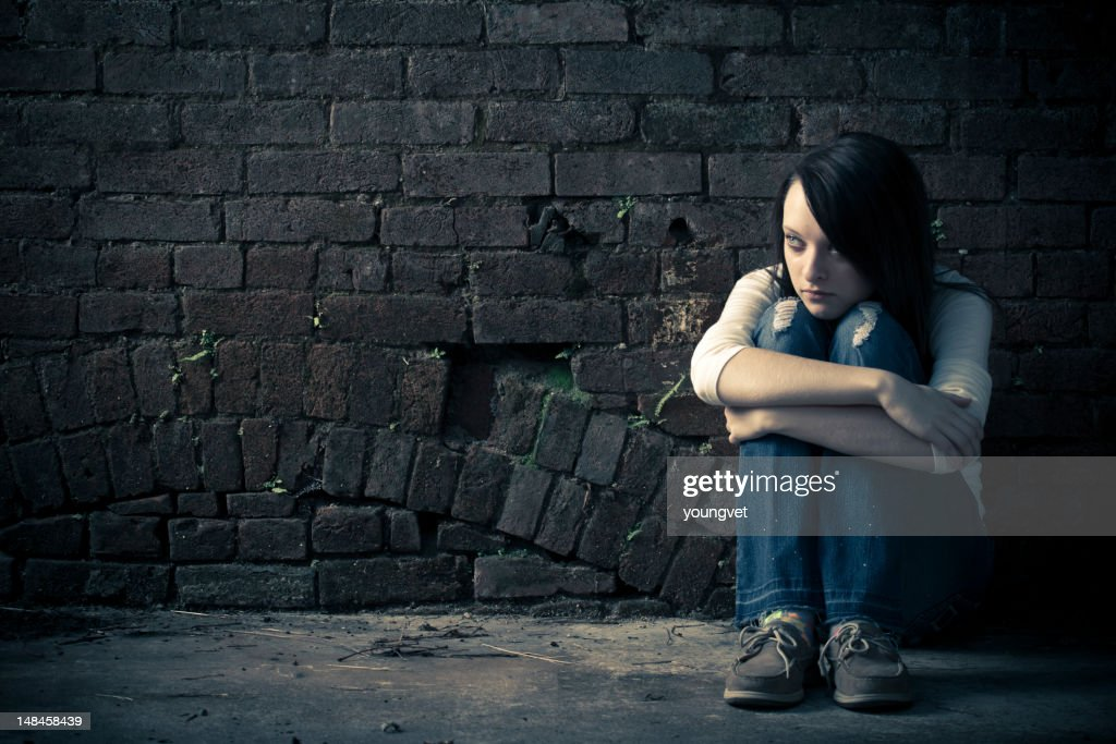 Lonely and scared runaway teenage girl : Stock Photo