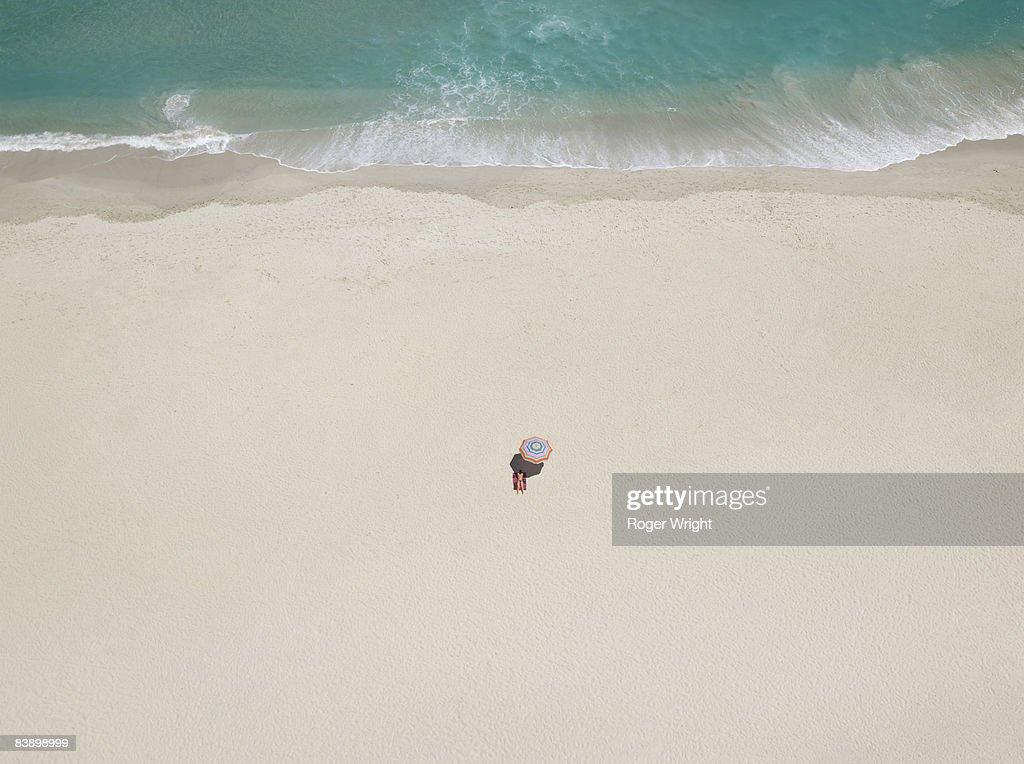 Single woman on beach : Stock Photo