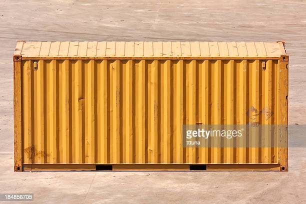 A single yellow cargo container