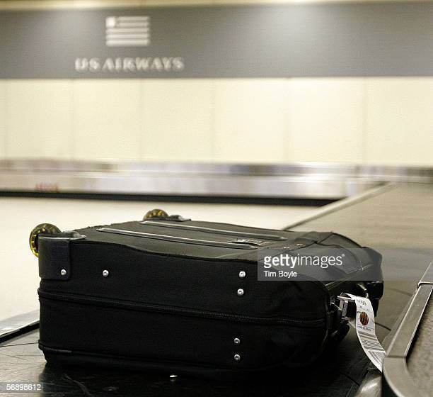 A single yettobeclaimed piece of luggage is seen at the US Airways luggage claim area February 21 2006 at O'Hare International Airport in Chicago...