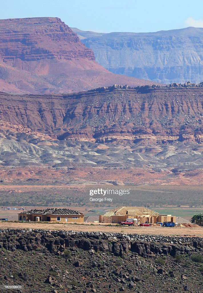Single-family homes located on a ridge are shown under construction September 27, 2013 in St. George, Utah. Housing starts on single-family rose at a faster pace in August, and building permits rose to a five-year high, according to published reports this week.