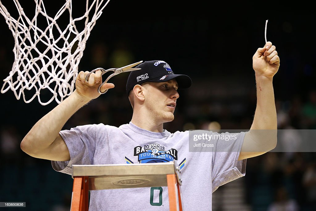 E.J. Singler #25 of the Oregon Ducks celebrates by cutting down the net after they defeated the UCLA Bruins 78 to 69 in the Pac-12 Championship game at MGM Grand Garden Arena on March 16, 2013 in Las Vegas, Nevada.