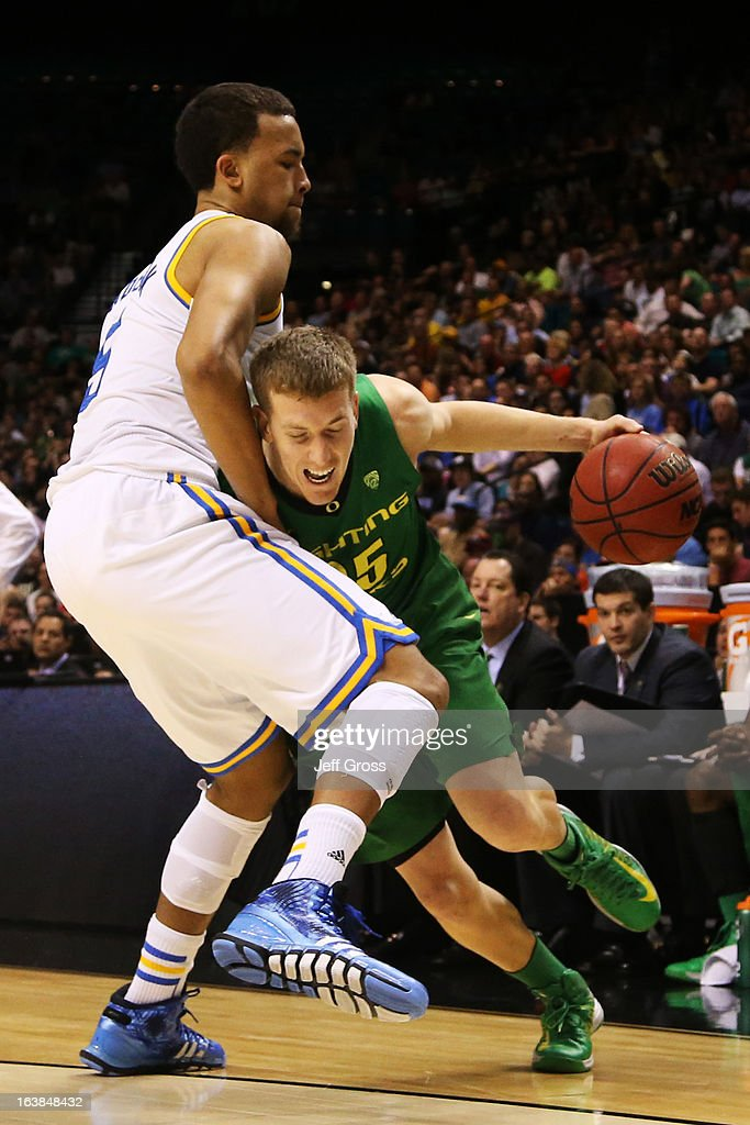 E.J. Singler #25 of the Oregon Ducks drives against Kyle Anderson #5 of the UCLA Bruins in the second half of the Pac-12 Championship game at MGM Grand Garden Arena on March 16, 2013 in Las Vegas, Nevada.
