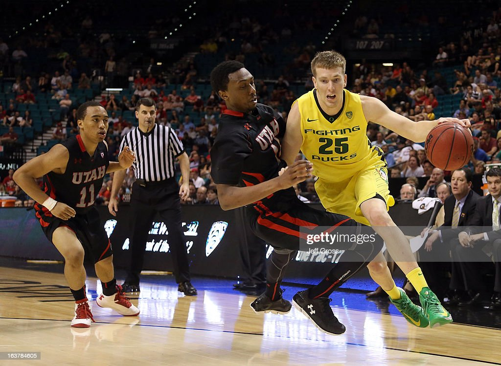 E.J. Singler #25 of the Oregon Ducks drives on Dakarai Tucker #14 of the Utah Utes in the second half during the semifinals of the Pac-12 tournament at the MGM Grand Garden Arena on March 14, 2013 in Las Vegas, Nevada.