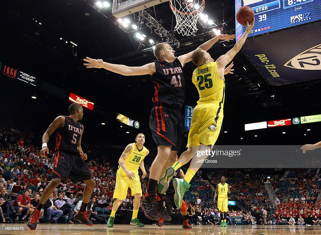 E.J. Singler #25 of the Oregon Ducks goes up for a shot against Jeremy Olsen #41 of the Utah Utes in the second half during the semifinals of the Pac-12 tournament at the MGM Grand Garden Arena on March 14, 2013 in Las Vegas, Nevada.