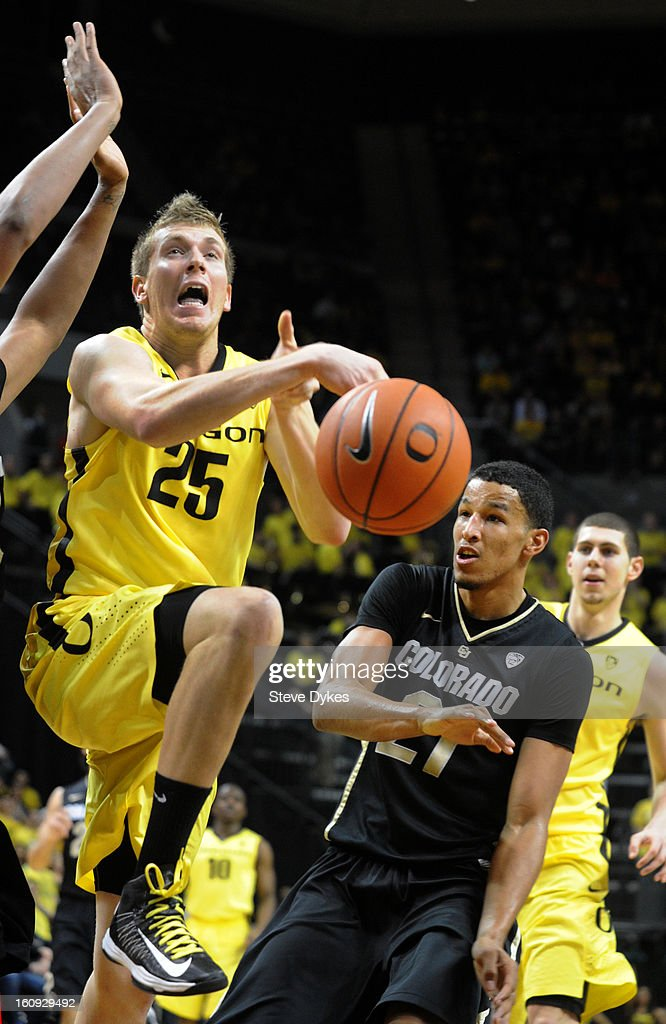 E.J. Singler #25 of the Oregon Ducks has the ball knocked away from him by Andre Roberson #21 of the Colorado Buffaloes in the second half of the game at Matthew Knight Arena on February 7, 2013 in Eugene, Oregon. Colorado won the game 48-47.