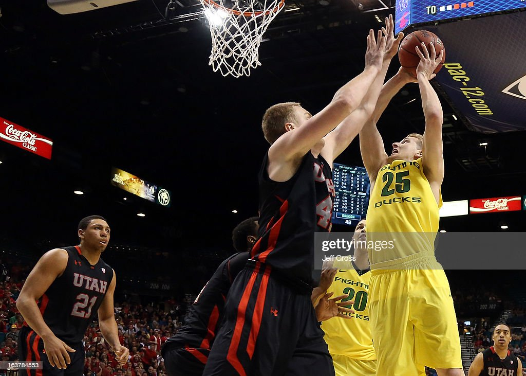 E.J. Singler #25 of the Oregon Ducks shoots the ball over Jeremy Olsen #41 of the Utah Utes in the second half during the semifinals of the Pac-12 tournament at the MGM Grand Garden Arena on March 14, 2013 in Las Vegas, Nevada.