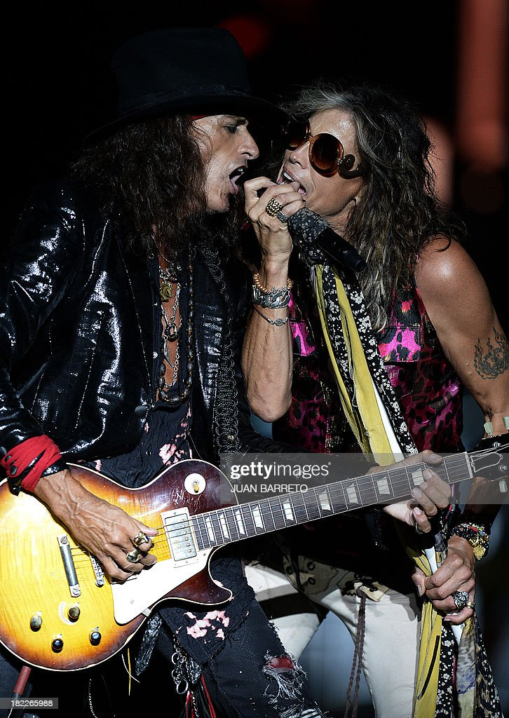 US singler Steven Tyler (R) and Joe Perry of Aerosmith perform during a concert in Caracas September 28, 2013.